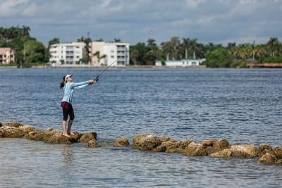 A Lantana woman fishes at the Boynton Beach Inlet, Wednesday, September 30, 2020. [JOSEPH FORZANO/palmbeachpost.com]
