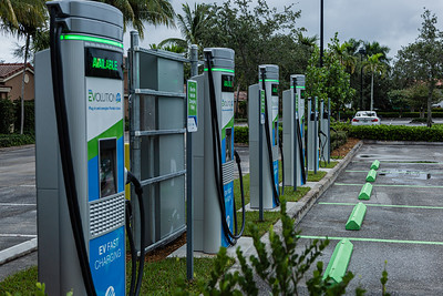 The new EVolution charging station at Midtown in Palm Beach Gardens, Friday, October 2, 2020. There are four Level 3 (fast) charging stations, and two Level 2 (slower charging) stations at the site. Florida Power & Light is commemorating National Drive Electric Week with the debut of a new electric vehicle universal fast-charging station at Mainstream in Midtown in Palm Beach Gardens. Customers will be charged about 30 cents per kilowatt hour to charge their electric vehicles. [JOSEPH FORZANO/palmbeachpost.com]