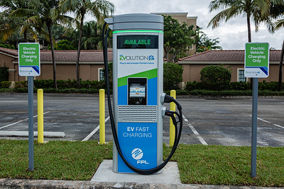 One of four fast charging stations at Midtown in Palm Beach Gardens, Friday, October 2, 2020. Florida Power & Light is commemorating National Drive Electric Week with the debut of a new electric vehicle universal fast-charging station at Mainstream in Midtown in Palm Beach Gardens. Customers will be charged about 30 cents per kilowatt hour to charge their electric vehicles. [JOSEPH FORZANO/palmbeachpost.com]
