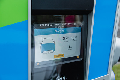 The charging stations at the new EVolution charging station at Midtown in Palm Beach Gardens display the percentage of battery charged, miles that can be driven and the kilowatt hours, Friday, October 2, 2020. There are four Level 3 (fast) charging stations, and two Level 2 (slower charging) stations at the site. Florida Power & Light is commemorating National Drive Electric Week with the debut of a new electric vehicle universal fast-charging station at Mainstream in Midtown in Palm Beach Gardens. Customers will be charged about 30 cents per kilowatt hour to charge their electric vehicles. [JOSEPH FORZANO/palmbeachpost.com]