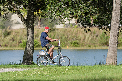 A man rides a bicycle on one of the many trails at Okeeheelee Park in West Palm Beach, Wednesday, October 7, 2020. (JOSEPH FORZANO / THE PALM BEACH POST)