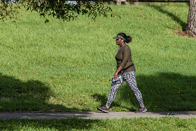 A woman walks on one of the many trails at Okeeheelee Park in West Palm Beach, Wednesday, October 7, 2020. (JOSEPH FORZANO / THE PALM BEACH POST)