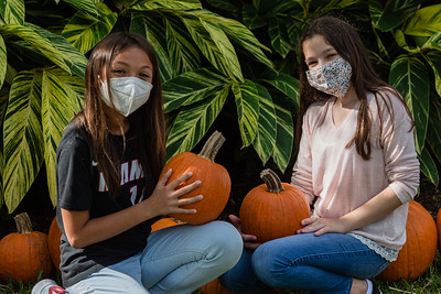 Francesca Duffy and Angie Tapper of Wellington hold the pumpkins they picked at the The Royal Poinciana Plaza's Pop-Up Patch for Philanthropy benefitting Cancer Alliance of Help and Hope, Saturday, October 10, 2020. 100 percent of the funds raised from the pumpkin patch will be used to help local cancer patients with their rent/mortgage, utilities, car insurance, car payment and health insurance while undergoing treatment. It's estimated that there will be about 5,000 pumpkins over the duration of the event.(JOSEPH FORZANO / THE PALM BEACH DAILY NEWS)