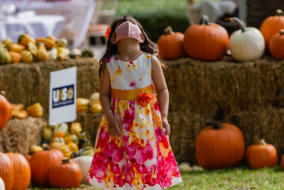 Bella Carmona of West Palm Beach watches a butterfly flutter over her head at the The Royal Poinciana Plaza's Pop-Up Patch for Philanthropy benefitting Cancer Alliance of Help and Hope, Saturday, October 10, 2020. 100 percent of the funds raised from the pumpkin patch will be used to help local cancer patients with their rent/mortgage, utilities, car insurance, car payment and health insurance while undergoing treatment. It's estimated that there will be about 5,000 pumpkins over the duration of the event.(JOSEPH FORZANO / THE PALM BEACH DAILY NEWS)
