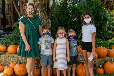 Alaina Witherell, Luca Murgio, Avelina Witherell, Cade Murgio and Alivia Murgio of Palm Beach Gardens pose for a photo at the The Royal Poinciana Plaza's Pop-Up Patch for Philanthropy benefitting Cancer Alliance of Help and Hope, Saturday, October 10, 2020. 100 percent of the funds raised from the pumpkin patch will be used to help local cancer patients with their rent/mortgage, utilities, car insurance, car payment and health insurance while undergoing treatment. It's estimated that there will be about 5,000 pumpkins over the duration of the event.(JOSEPH FORZANO / THE PALM BEACH DAILY NEWS)