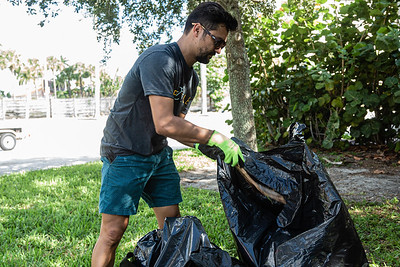 Juan Orellana of West Palm Beach organized the litter pick-up event at the Currie Park Marina in West Palm Beach, Sunday, October 11, 2020. Orellana, along with a group of volunteers is doing their part to clean up to try and clean up the pervasive litter problem in West Palm Beach. (JOSEPH FORZANO / THE PALM BEACH POST)