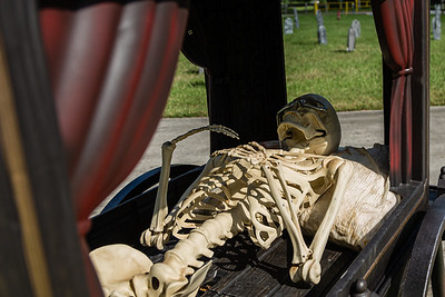 The unfortunate passenger of the funeral hearse at the Wellington Drive-Thru Creepy Crawl at Village Park, Wednesday, October 14, 2020. The Creepy Crawl will take place on Saturday, October 17 starting at 6 p.m. Visitors will drive their cars through Village Park in one direction and pass a series of scare areas, including an area designed for older kids with more intense scares. (JOSEPH FORZANO / THE PALM BEACH POST)