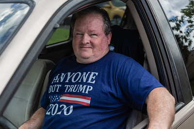 """Bob Markey of Royal Palm Beach, a lifelong Republican waits in his car for a Biden/Harris sign for his lawn at the DNC campaign office in West Palm Beach, Thursday, October 15, 2020. Markey is voting for Democrat for the first time in his life, saying, """"That's how much this election means to me."""" Markey has voted Republican in every election since 1978. (JOSEPH FORZANO / THE PALM BEACH POST)"""
