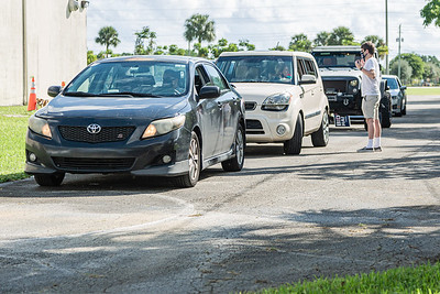 Cars line up at the DNC campaign office in West Palm Beach to get Biden/Harris lawn signs from DNC National Chairman Tom Perez, Florida Agriculture Commissioner Nikki Fried and Florida Democratic Party Chair Terrie Rizzo, Thursday, October 15, 2020. (JOSEPH FORZANO / THE PALM BEACH POST)