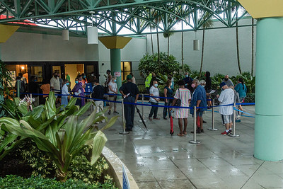 A line of early voters waits outside of the Palm Beach County Library on Summit Blvd., Monday, October 19, 2020. Statewide early voting started today. (JOSEPH FORZANO / THE PALM BEACH POST)