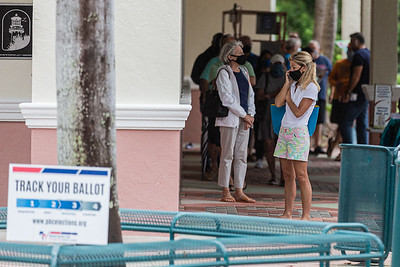 Early voters wait in line at the Jupiter Community Center in Jupiter, Wednesday, October 21, 2020. Statewide early voting started in Florida on Monday. (JOSEPH FORZANO / THE PALM BEACH POST)
