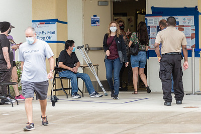 Early voters leave the polling place at the West Boca Branch Library in Boca Raton, Friday, October 23, 2020. Statewide early voting started in Florida on Monday. (JOSEPH FORZANO / THE PALM BEACH POST)