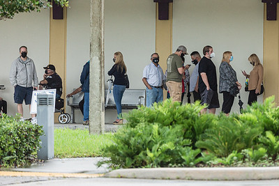 Early voters wait in line at the West Boca Branch Library in Boca Raton, Friday, October 23, 2020. Statewide early voting started in Florida on Monday. (JOSEPH FORZANO / THE PALM BEACH POST)