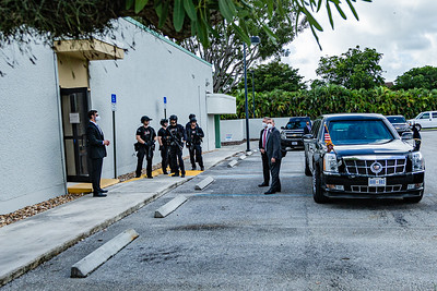 """Secret Service agents wait outside the on Summit Blvd. next the the Presidential limousine, also called """"The Beast"""". President Donald J. Trump cast an early ballot for the 2020 presidential election at the  library on Summit Blvd. in West Palm Beach, Saturday October 22, 2020. (JOSEPH FORZANO / THE PALM BEACH POST)"""