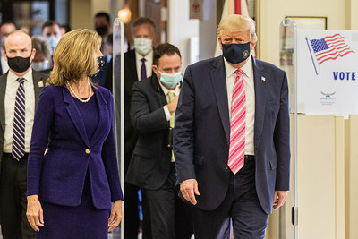 """President Donald J. Trump (right) leaves the voting area with Palm Beach County Supervisor of Elections Wendy Sartori Link. The President cast an early ballot for the 2020 presidential election at the main branch of the Palm Beach County library on Summit Blvd. in West Palm Beach, Saturday October 22, 2020. When asked who he voted for, the President replied, """"Some guy named Trump."""" (JOSEPH FORZANO / THE PALM BEACH POST)"""