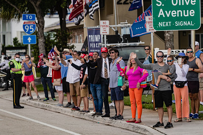 Supporters wave to the Presidential motorcade as it travels west along Southern Blvd. as it heads to the main branch of the Palm Beach County library on Summit Blvd. in West Palm Beach, Saturday, October 24, 2020. President Donald J. Trump cast his ballot for the 2020 presidential election at the library this morning. (JOSEPH FORZANO / THE PALM BEACH POST)