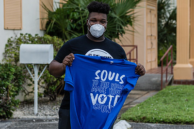 Sammie Brown of Riviera Beach shows off his Souls to the Polls t-shirt in front of the St. James Missionary Baptist Church in Riviera Beach on Sunday, October 25, 2020. Members of the congregation were escorted to the polling place at Wells Recreation Center in Riviera Beach. The event was organized by Faith in Florida. (JOSEPH FORZANO / THE PALM BEACH POST)
