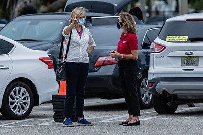 Audrey Stimson, a Los Angeles based TV producer working with ARD German Television speaks with Palm Beach County Supervisor of Elections Wendy Sartori Link at the Wells Recreation Center in Riviera Beach, Sunday, October 25, 2020. The group Black Men Stand Up organized an event to ensure at least 500 black men voted on Sunday. (JOSEPH FORZANO / THE PALM BEACH POST)
