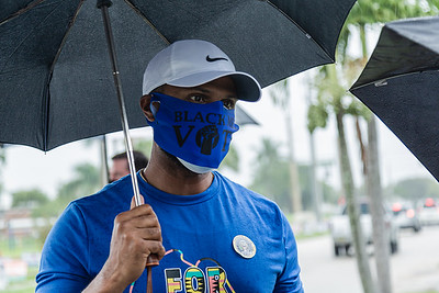 Riviera Beach Commissioner Cory Neering speaks to the media at the Wells Recreation Center in Riviera Beach, Sunday, October 25, 2020. The group Black Men Stand Up organized an event to ensure at least 500 black men voted on Sunday. (JOSEPH FORZANO / THE PALM BEACH POST)