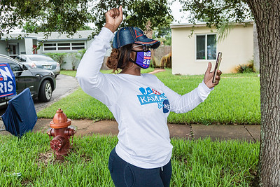 Mika Wells, Coalition Director for the Biden campaign cheers the Souls to the Polls caravan as it arrives at the Wells Recreation Center, Sunday, October 25, 2020. Members of the congregation were escorted to the polling place at Wells Recreation Center in Riviera Beach. The event was organized by Faith in Florida. (JOSEPH FORZANO / THE PALM BEACH POST)