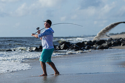R.J. Vitolo of Delray fishes for jacks from the shore of the Boynton Beach Inlet, Tuesday, October 27, 2020. Vitolo comes to the Boynton Inlet to fish every day. (JOSEPH FORZANO / THE PALM BEACH POST)