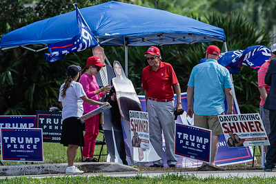 Supporters of President Donald J. Trump gather outside the West Boca Branch Library in Boca Raton on Election Day, November 3, 2020. Voters were in and out in under 10 minutes. (JOSEPH FORZANO / THE PALM BEACH POST)