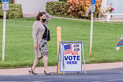 A voter leaves the Ascension Catholic Church in Boca Raton, on Election Day, Tuesday, November 3, 2020. (JOSEPH FORZANO / THE PALM BEACH POST)