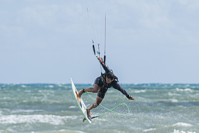 A kite surfer loses altitude after a large wave shot him skyward at Juno Beach, Wednesday, November 4, 2020. A 17 knot wind with gusts up to 27 knots churned up the ocean and brought out the kite surfers. (JOSEPH FORZANO / THE PALM BEACH POST)