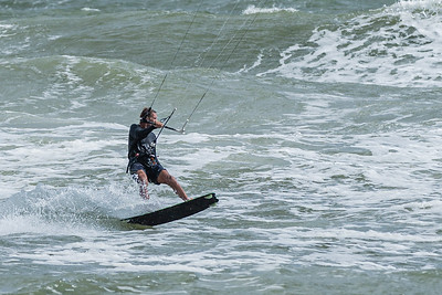 A kite surfer glides over a rough ocean at Juno Beach, Wednesday, November 4, 2020. A 17 knot wind with gusts up to 27 knots churned up the ocean and brought out the kite surfers. (JOSEPH FORZANO / THE PALM BEACH POST)