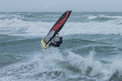 A windsurfer sails over the waters off of Jupiter Beach in Jupiter, where winds from the passing of Tropical Storm Eta reached upwards of 20 knots, Monday, November 9, 2020. (JOSEPH FORZANO / THE PALM BEACH POST)