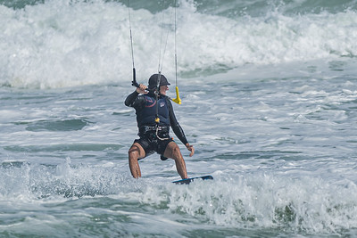 A kite surfer sails over the waters off of Jupiter Beach in Jupiter, where winds from the passing of Tropical Storm Eta reached upwards of 20 knots, Monday, November 9, 2020. (JOSEPH FORZANO / THE PALM BEACH POST)