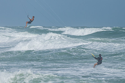 A pair of kite surfers fly over the waters off of Jupiter Beach in Jupiter, where winds from the passing of Tropical Storm Eta reached upwards of 20 knots, Monday, November 9, 2020. (JOSEPH FORZANO / THE PALM BEACH POST)