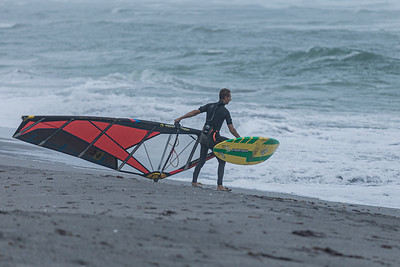 A windsurfer prepares to put his rig in the water off Jupiter Beach where winds from the passing of Tropical Storm Eta reached upwards of 20 knots, Monday, November 9, 2020. (JOSEPH FORZANO / THE PALM BEACH POST)