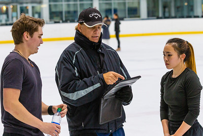 2-time Olympic ice dancing gold medalist Evgeny Platov (center) reviews video footage of practice of ice dancing team Temirlan Yerzhanov and Maxine Weatherby at Palm Beach Ice Works in West Palm Beach on Friday, December 13, 2020.  Weatherby and Yerzhanov have been ice dancing partners for two years and will be representing Kazakhstan - Yerzhanov's home country - in the Worlds in March 2021 in Sweden. Their goal is to qualify and skate in the 2022 Winter Olympics in China. (JOSEPH FORZANO / THE PALM BEACH POST)