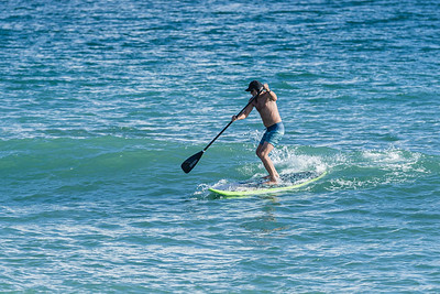 A paddle boarder rides a small wave off the coast at Carlin Park in Jupiter, Monday, November 19, 2020.  A 9 knot wind out of the north east produced two foot waves off the coast. (JOSEPH FORZANO / THE PALM BEACH POST)