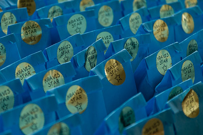 Gift bags are lined up on a table for the Kravis Center volunteers who were being honored by staff members at the Kravis Center for the Performing Arts Drive-Through Volunteer Salute, in West Palm Beach, Tuesday, November 17, 2020. The gift bags contained a keychain, pen and notepad, sanitizing wipes and Dunkin Donuts gift cards. The event was hosted to thank the dedicated volunteers who devote their time and effort  at the Kravis Center throughout the year. (JOSEPH FORZANO / THE PALM BEACH POST)