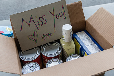 "A volunteer hid a ""Miss You"" note in a box of non-perishable food donated at the Kravis Center for the Performing Arts Drive-Through Volunteer Salute, in West Palm Beach, Tuesday, November 17, 2020. The event was hosted to allow staff to thank the dedicated volunteers who devote their time and effort  at the Kravis Center throughout the year and also collect donated food for the Palm Beach Food Bank. (JOSEPH FORZANO / THE PALM BEACH POST)"