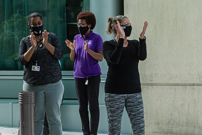 Bonnie Cillo (right) from the Kravis Center IT departments claps along with other staff members for the volunteers as they drive through the valet area during the Kravis Center for the Performing Arts Drive-Through Volunteer Salute, in West Palm Beach, Tuesday, November 17, 2020. The event was hosted to allow staff to thank the dedicated volunteers who devote their time and effort  at the Kravis Center throughout the year. (JOSEPH FORZANO / THE PALM BEACH POST)