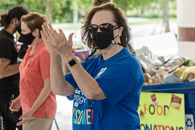 Judy Mitchell, Chief Executive Officer of the Kravis Center claps and cheers for the volunteers as they drive through the valet area during the Kravis Center for the Performing Arts Drive-Through Volunteer Salute, in West Palm Beach, Tuesday, November 17, 2020. The event was hosted to allow staff to thank the dedicated volunteers who devote their time and effort  at the Kravis Center throughout the year. (JOSEPH FORZANO / THE PALM BEACH POST)