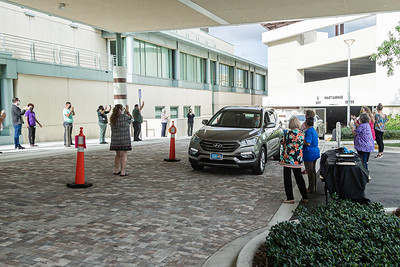 Staff members of the Kravis Center clap and cheer as the first of the volunteers drives through the valet area during the Kravis Center for the Performing Arts Drive-Through Volunteer Salute, in West Palm Beach, Tuesday, November 17, 2020. The event was hosted to allow staff to thank the dedicated volunteers who devote their time and effort  at the Kravis Center throughout the year. (JOSEPH FORZANO / THE PALM BEACH POST)