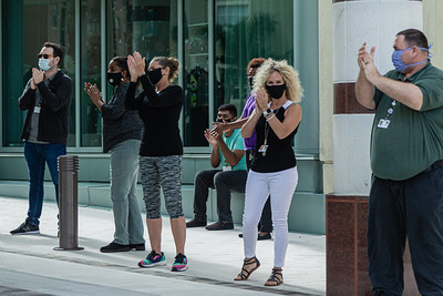 Staff members of the Kravis Center clap and cheer for the volunteers as they drive through the valet area during the Kravis Center for the Performing Arts Drive-Through Volunteer Salute, in West Palm Beach, Tuesday, November 17, 2020. The event was hosted to allow staff to thank the dedicated volunteers who devote their time and effort  at the Kravis Center throughout the year. (JOSEPH FORZANO / THE PALM BEACH POST)