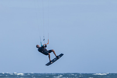 Tony Sacco, 60, of Lake Clark Shores, gets huge air while kite surfing  in the waters off the Boynton Beach Inlet, Thursday, November 19, 2020. Sacco has been kite surfing for 15 years and wanted to take advantage of the 19 knot winds out of the north east. (JOSEPH FORZANO / THE PALM BEACH POST)