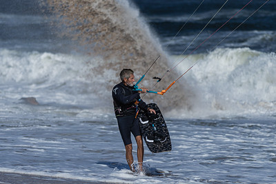 Tony Sacco, 60, of Lake Clark Shores, prepares to get into the water to kite surf off the Boynton Beach Inlet, Thursday, November 19, 2020. Sacco has been kite surfing for 15 years and wanted to take advantage of the 19 knot winds out of the north east. (JOSEPH FORZANO / THE PALM BEACH POST)