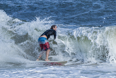 A surfer is about to wipe out on a wave at the Boynton Beach Inlet, Thursday, November 19, 2020. 19 knot winds out of the north east churned up nine foot waves at the inlet. (JOSEPH FORZANO / THE PALM BEACH POST)