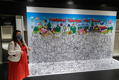 Whitney Jester, Director of Marketing and Merchant Relations for the Palm Beach Gardens Mall in Palm Beach Gardens shows part of the new Holiday Wander attraction, Thursday, November 19, 2020.  The Holiday Wander will opens on November 28 and runs through Christmas Eve. (JOSEPH FORZANO / THE PALM BEACH POST)