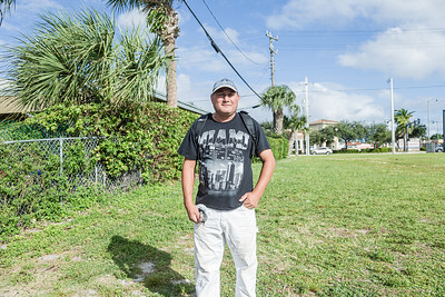 Leonides Hernandez waits on the corner of Broadway Avenue and 44th Street in West Palm Beach for a company who needs labor help, Friday, November 20, 2020. Hernandez, 50, lives in West Palm Beach and has been a day laborer for 5 years. He is able to any kind of work from remodeling to painting and landscaping. (JOSEPH FORZANO / THE PALM BEACH POST)