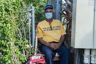 Carlos (no last name given), sits on a makeshift seat as he waits on the corner of Broadway Avenue and 44th Street in West Palm Beach for a company who needs labor help, Friday, November 20, 2020. Carlos, 50, originally from Columbia, lives in West Palm Beach and has been a day laborer for 8 years. He is able to do any kind of labor. (JOSEPH FORZANO / THE PALM BEACH POST)