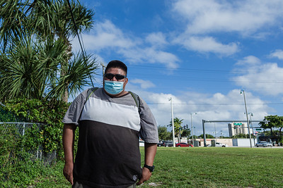 Albert (no last name given), waits on the corner of Broadway Avenue and 44th Street in West Palm Beach for a company who needs labor help, Friday, November 20, 2020. Albert, 33, originally from Mexico, lives in West Palm Beach and has been a day laborer for 2 years. He is an experienced warehouse worker.  (JOSEPH FORZANO / THE PALM BEACH POST)