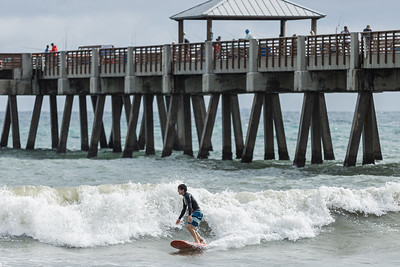 A surfer rides a small wave near the Juno Beach Pier in Juno Beach, Monday, November 23, 2020. 10 knot winds out of the north northwest made for small three foot waves at the beach. (JOSEPH FORZANO / THE PALM BEACH POST)
