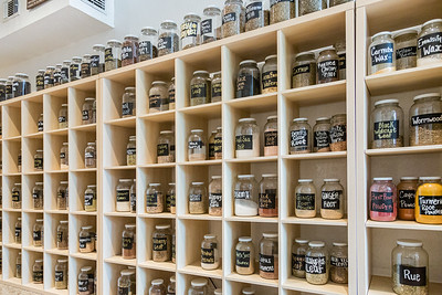 Rows of jars filled with dried herbs line the wall at Herbs & Earth, in Northwood Village, Saturday, November 28, 2020. (JOSEPH FORZANO / THE PALM BEACH POST)